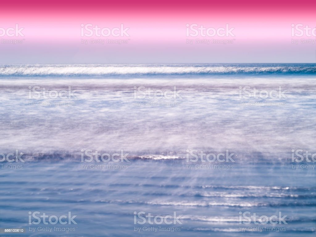 Vivid milk ocean horizon tidal waves background stock photo