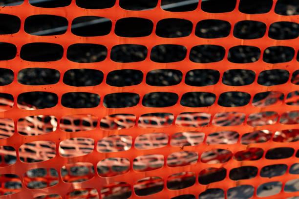 Vivid orange construction safety net stock photo