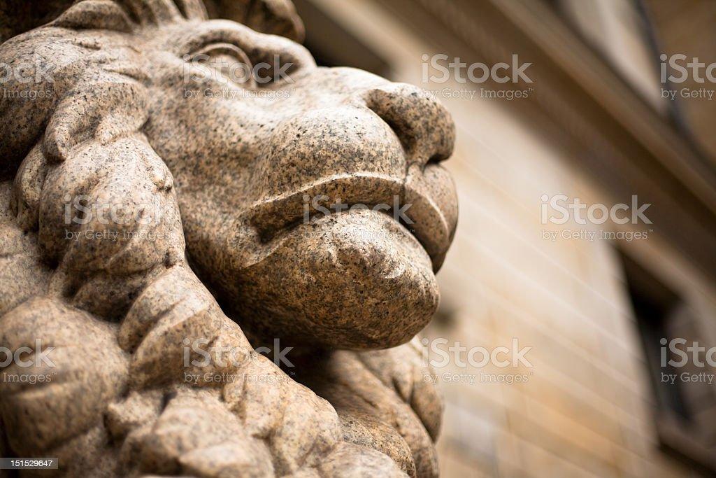 Vivid stone lion head sculpture of an ancient building stock photo