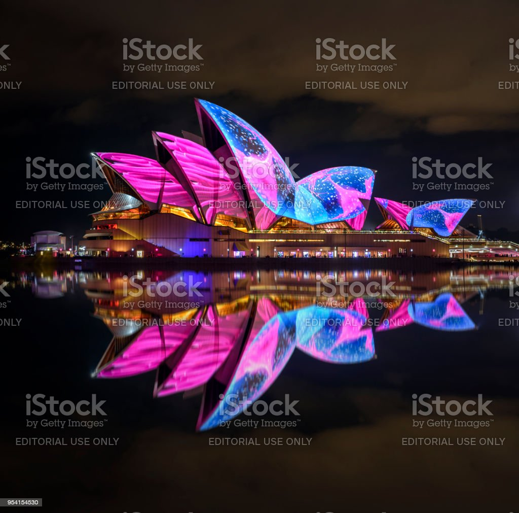 Vivid Sydney - Opera House Sydney, Australia - May 26, 2017: The Sydney Opera House has a colorful design projected onto its sails at night as part of the Vivid Sydney festival. Architecture Stock Photo