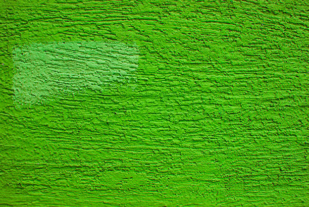 vivid yellow green wall - kelly green stock pictures, royalty-free photos & images