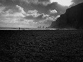 istock Vík í Mýrdal, Iceland: Person at Vikurfjara Black Sand Beach (B&W) 1182950018