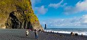 istock Vík í Mýrdal, Iceland: Tourists at Reynisfjara Black Sand Beach 1205423977