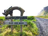 """istock Vík í Mýrdal, Iceland: """"Vikurfjara Black Sand Beach"""" Rustic Sign 1182950074"""
