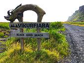 """istock Vík í Mýrdal, Iceland: """"Vikurfjara Black Sand Beach"""" Rustic Sign 1182950119"""