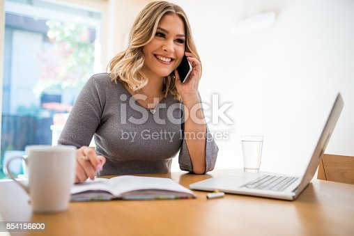 istock Vlogger filming herself working 854156600