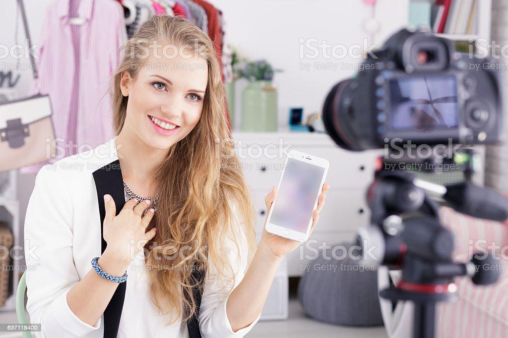 Vlogger holding smartphone stock photo