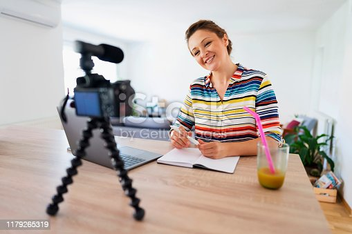 1179265329 istock photo Vlogger on the rise 1179265319