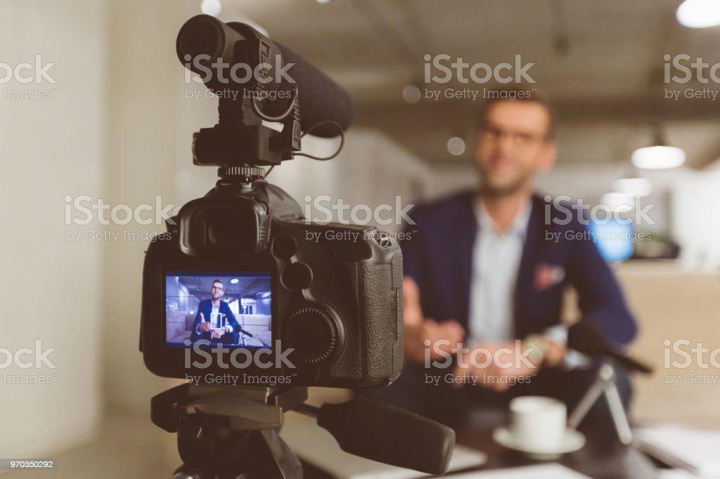 Vlogger recording content on camera stock photo