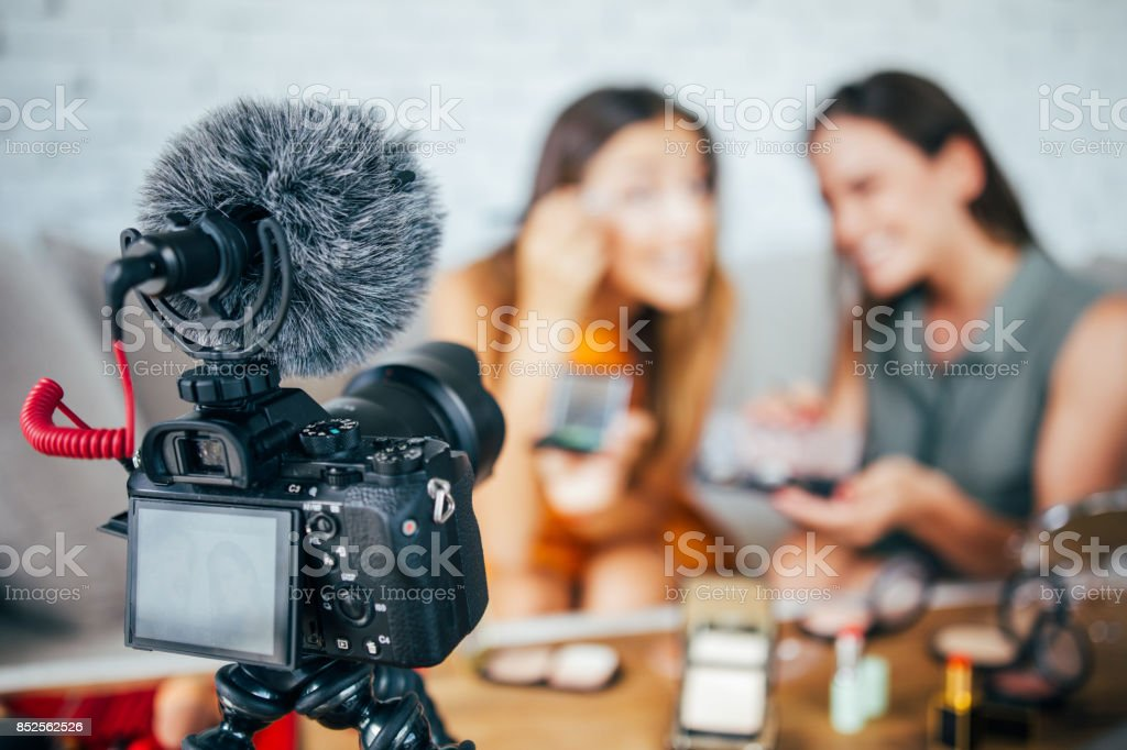 Vloggers reviewing make-up products stock photo