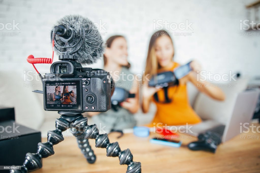 Vloggers reviewing VR technology stock photo