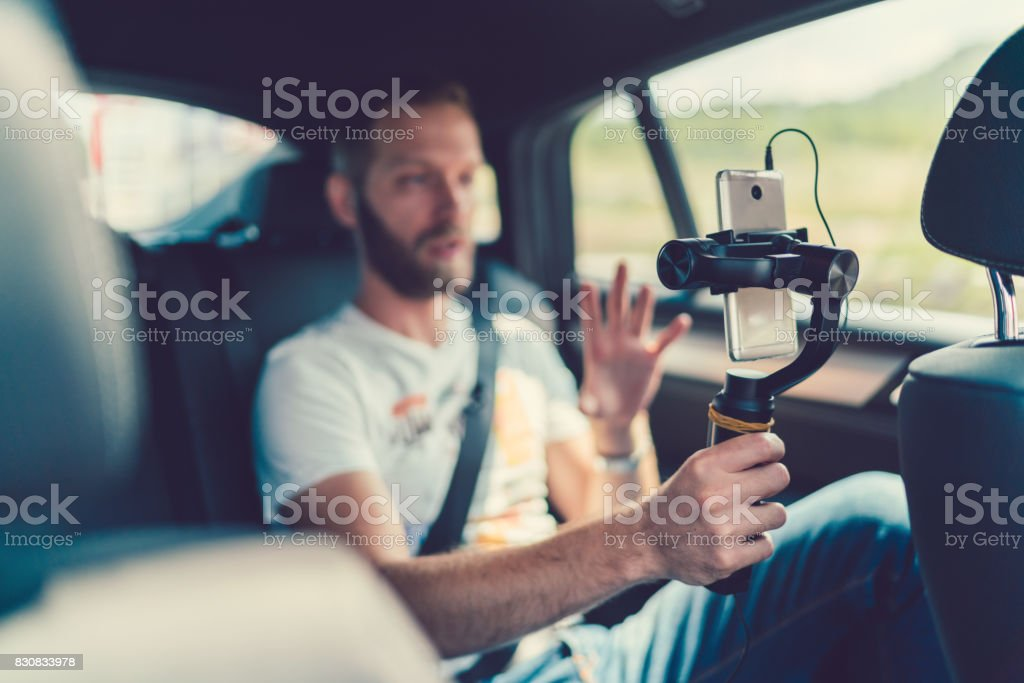 Vlogging Man vlogging in the car 30-39 Years Stock Photo