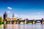 Charles bridge in Prague over the river Vltava in the afternoon. Czech Republic