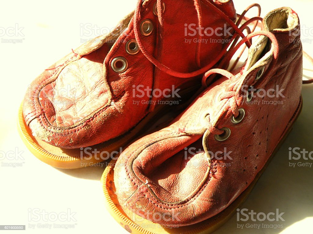 Vntage Baby Dolls Red Leather Shoes stock photo