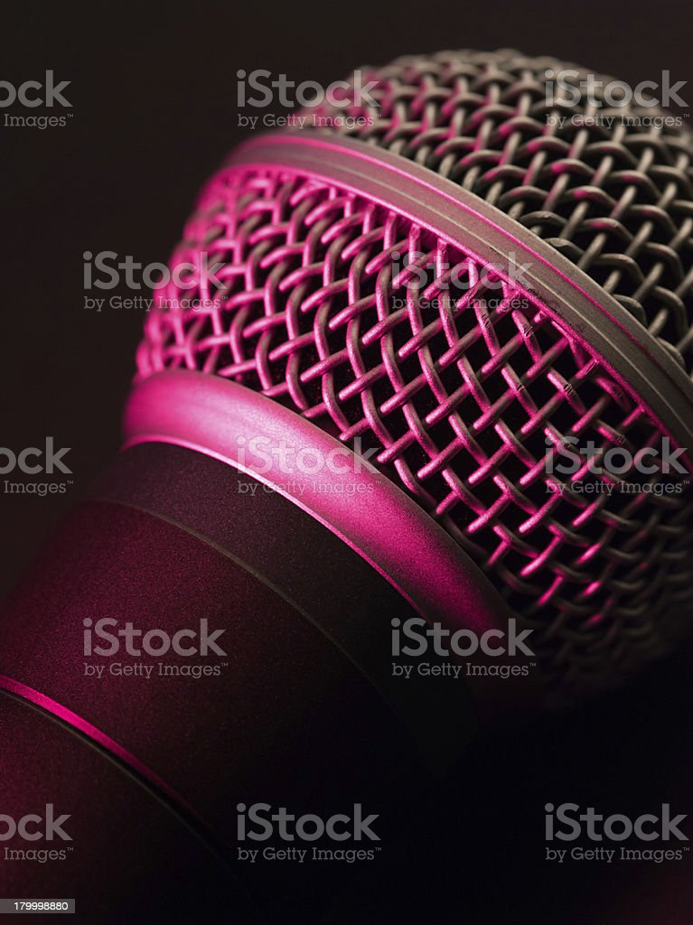 Vocal microphone in pink light royalty-free stock photo