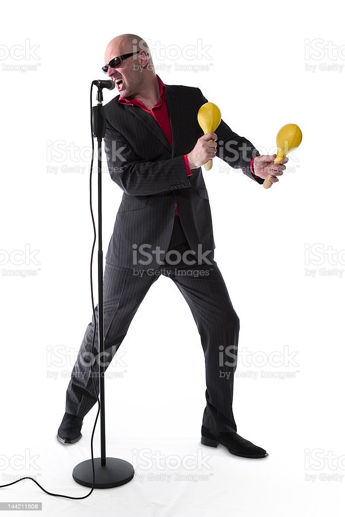 Vocalist with yellow maracas stock photo