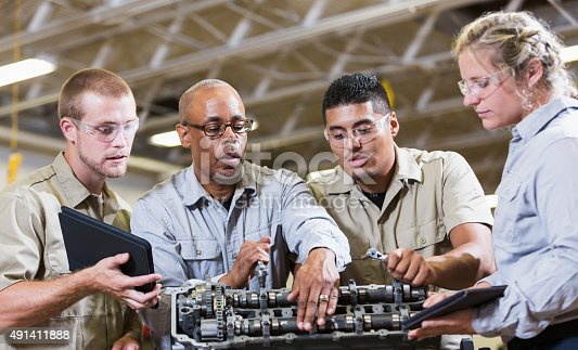 istock Vocational class, learning to repair gasoline engine 491411888
