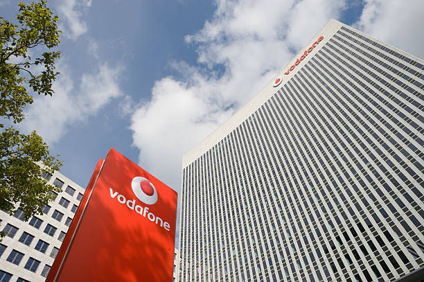 Vodafone office building in Eschborn, Germany Eschborn, Germany - October 9, 2011: Vodafon office buiding in Eschborn near Frankfurt. Vodafone is a global telecommunications company. TVodafone Group Plc is a British based company and the worlds largest global telecommunications company and the third largest company on the London Stock Exchange. AM stock pictures, royalty-free photos & images