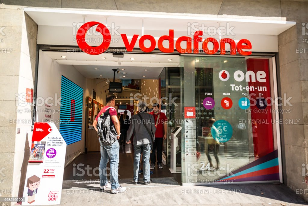 Vodafone Store in Barcelona city center with people at the entrance, Spain