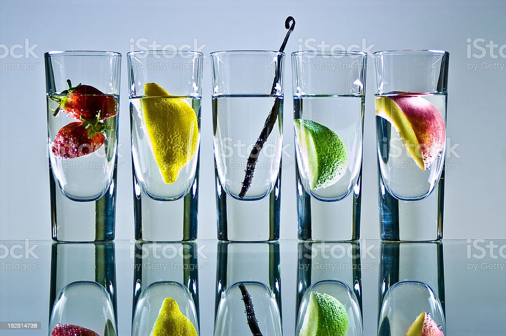 Vodka glasses with fruit stock photo