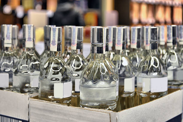 Vodka in a cardboard box Vodka in a cardboard box in the store vodka stock pictures, royalty-free photos & images