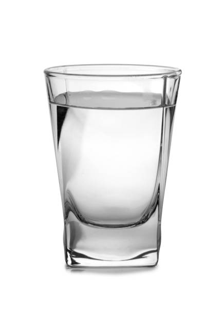 Vodka in vintage glass Vodka in a glass and decanter on a white background vodka stock pictures, royalty-free photos & images