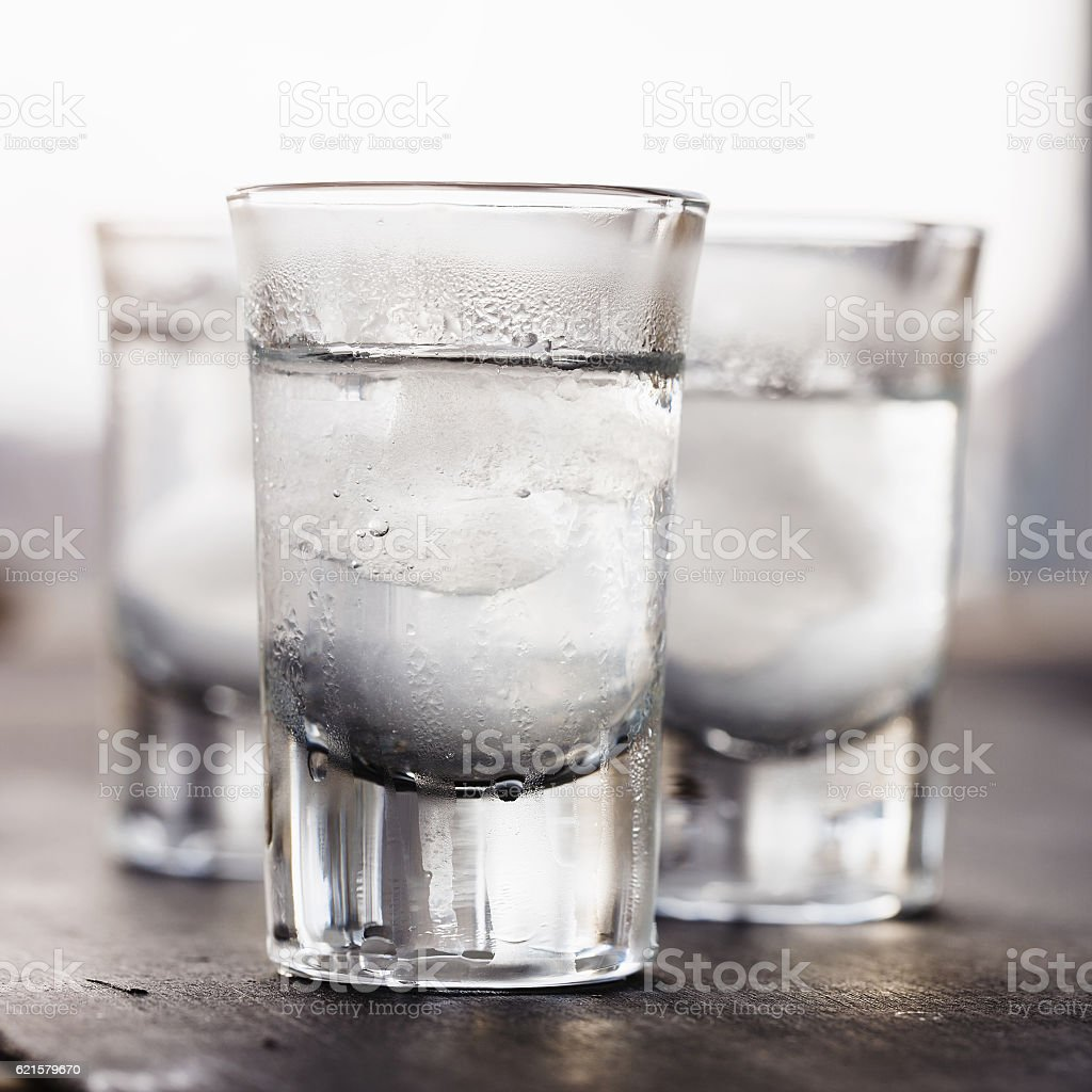 Vodka with ice in a glass stock photo