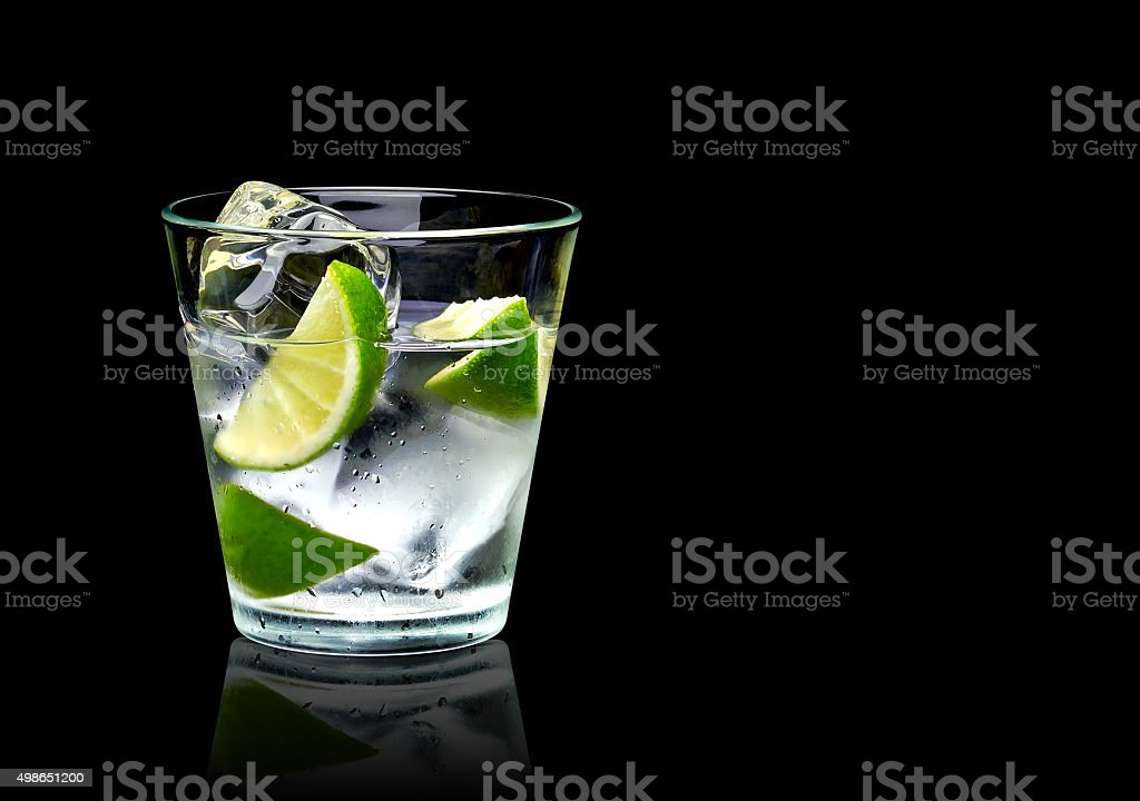 Vodka with lime and ice stock photo