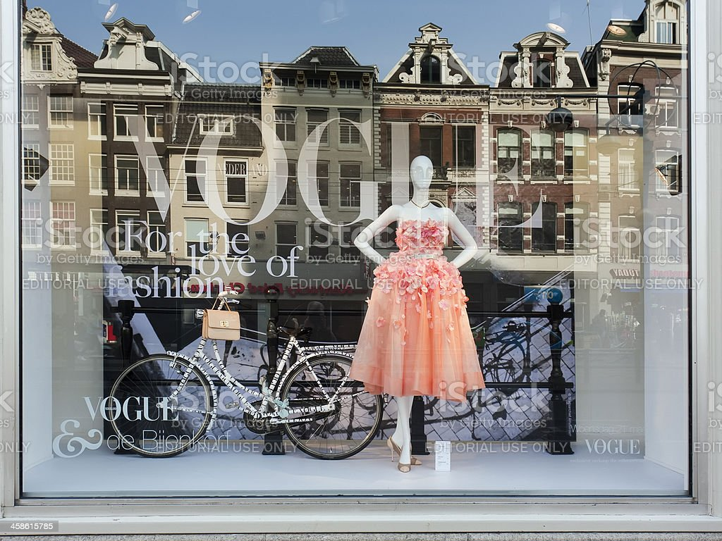 Vogue Fashion display window with reflection of old Amsterdam houses stock photo