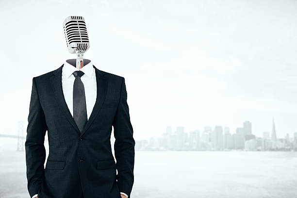 Voice concept Mic headed businessman on city background with copy space. Voice concept spokesperson stock pictures, royalty-free photos & images