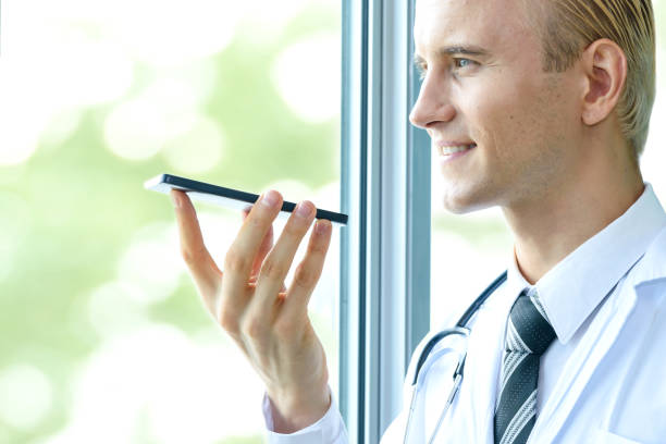 Voice recognition biometric , speech detect in healthcare technology concept. Doctor talk to smartphone for order command in hospital. stock photo
