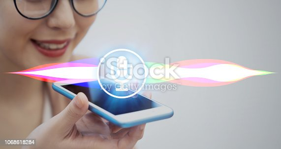 istock Voice recognition with smart phone. 1068618284