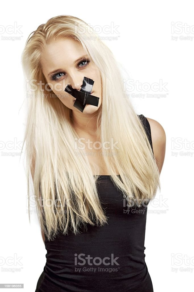 Voiceless Woman in a Struggle for Her Freedom royalty-free stock photo