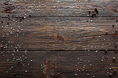 Void wooden background with spices. Top view