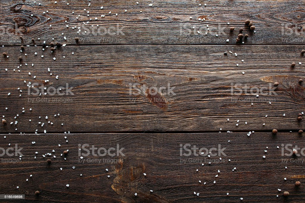 Void wooden background with spices. Top view stock photo