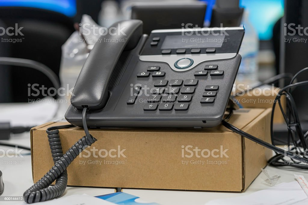 voip phone on the brown box for start use stock photo