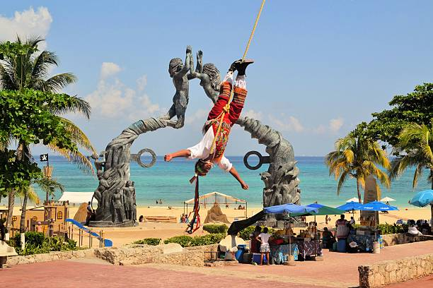 Voladores Acrobat performers at Flying Men Traditional Dance Ceremony in stock photo