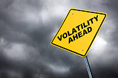 A road sign warning of volatility ahead against a stormyTo see more road signs click on the link below: