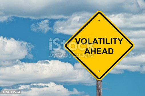 Volatility Ahead Caution Sign - Blue Sky Background