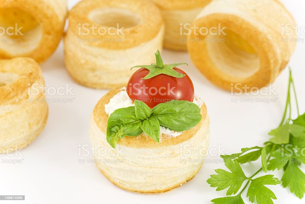 vol-au-vent with cheese, tomato and basil royalty-free stock photo