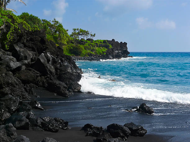 Volcanic black sand beach on Hawaii Black sand beach in Wai'anapanapa State Park along the famous road to Hana on Maui, Hawaii. black sand stock pictures, royalty-free photos & images