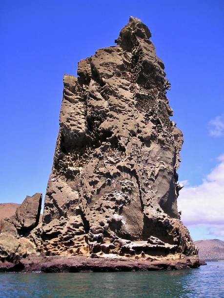 volcanic coastal outcrop, galapagos islands - mcdermp stock pictures, royalty-free photos & images