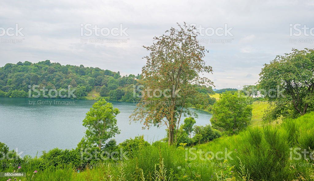 Volcanic crater lake in summer stock photo