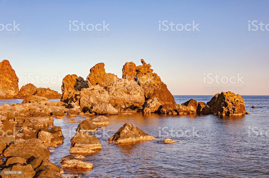 Volcanic formations in Acireale at sunset. - foto stock