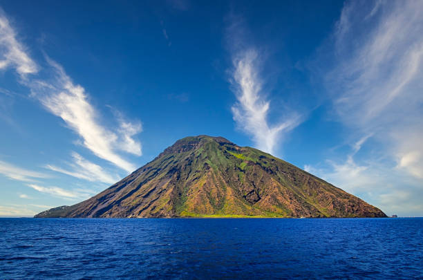 Volcanic island Stromboli in Lipari viewed from the ocean with nice clouds, Sicily stock photo