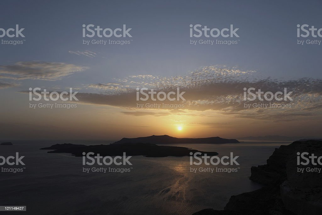 Volcanic Islands off The Coast of Santorini at Sunset stock photo