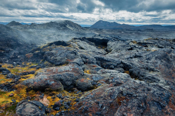 volcanic landscape under dramatic sky on Iceland stock photo