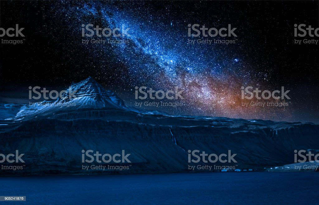 Volcanic mountain and milky way over fjord at night, Iceland stock photo