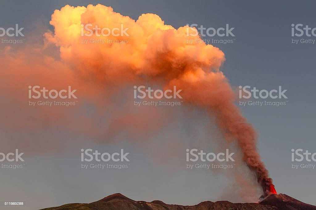 volcanic plume of Mount Etna at the dawn stock photo