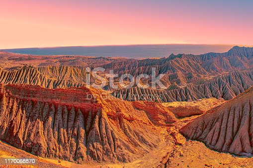 Sea view and volcanic mountains during sunset